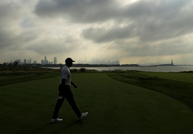 "<a class=""link rapid-noclick-resp"" href=""/pga/players/147/"" data-ylk=""slk:Tiger Woods"">Tiger Woods</a> early on Thursday morning at a nearly deserted Liberty National Golf Club. (Getty)"