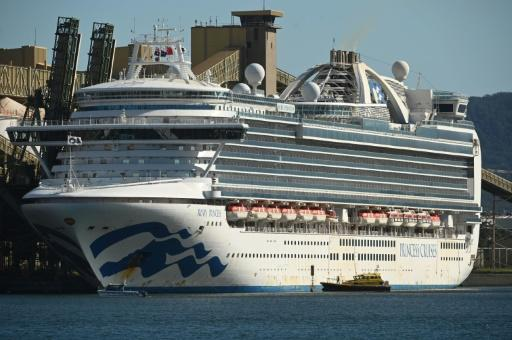 The cruise liner Ruby Princess sits in the harbour in Port Kembla, 80 kilometres (50 miles) south of Sydney after coming in to refuel and restock