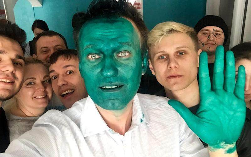 Alexei Navalny takes a selfie with supporters after an unknown assailant sprayed a bright green antiseptic on his face - AP