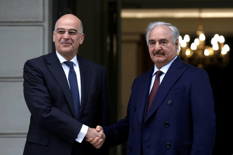 Greek Foreign Minister Nikos Dendias welcomes Libya's commander Khalifa Haftar at the Foreign Ministry in Athens