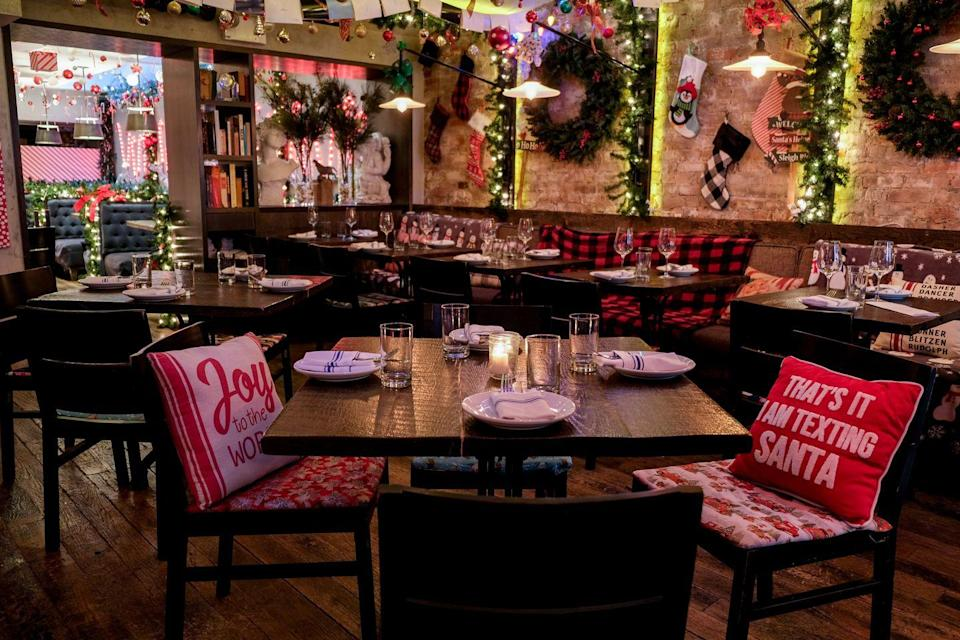 """<p>This rotating holiday lounge (it originally popped up in the East Village in 2017 before moving to Greenpoint last year) is taking over <a href=""""http://bbandcnyc.com/"""" rel=""""nofollow noopener"""" target=""""_blank"""" data-ylk=""""slk:Bell Book & Candle"""" class=""""link rapid-noclick-resp"""">Bell Book & Candle</a> in the West Village this holiday season with over the top seasonal decor and playful holiday-themed cocktails like the Coal For Christmas made with mint-infused vodka, lemon, coconut, and inky charcoal or the Scrooged with rosemary-infused bourbon, rum, and holiday spices. </p><p><em>Open through December 25, 2019, <em>Mon-Thurs 4PM-2AM, Friday-Sunday 12PM-2AM</em>. 141 w 10th Street.</em></p>"""