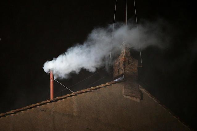 VATICAN CITY, VATICAN - MARCH 13: White smoke billows from the chimney on the roof of the Sistine Chapel indicating that the College of Cardinals have elected a new Pope on March 13, 2013 in Vatican City, Vatican. (Photo by Peter Macdiarmid/Getty Images)