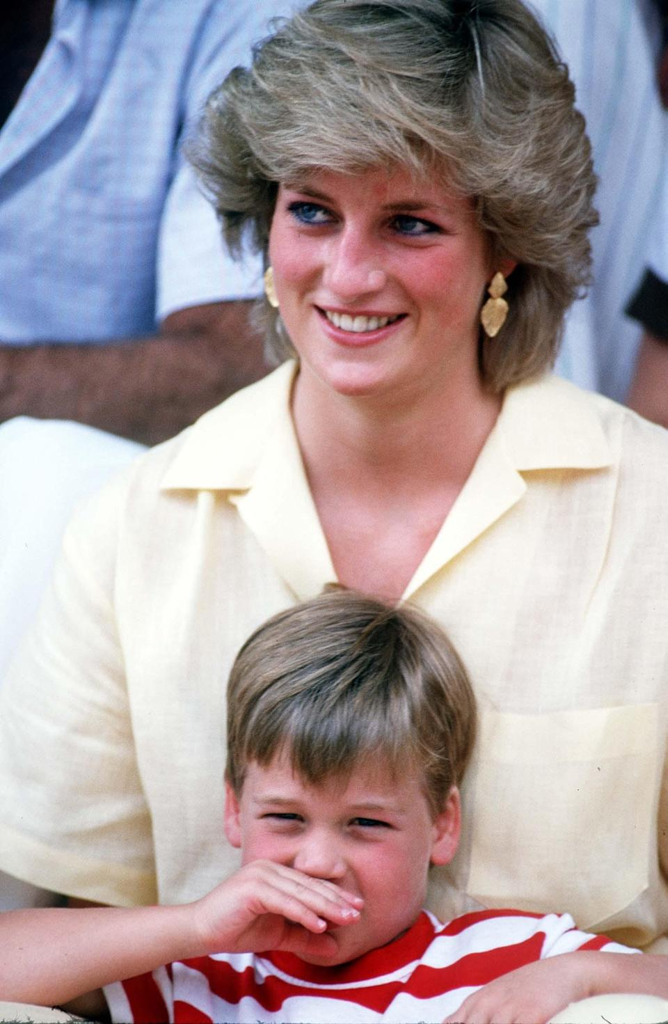 <p>Princess Diana looked relaxed during a holiday in Majorca with her boys, Prince Harry and Prince William. And this was reflected through sartorial means as she donned lemon yellow to accompany her tan and opted for a more relaxed hairstyle.<br><em>[Photo: PA]</em> </p>