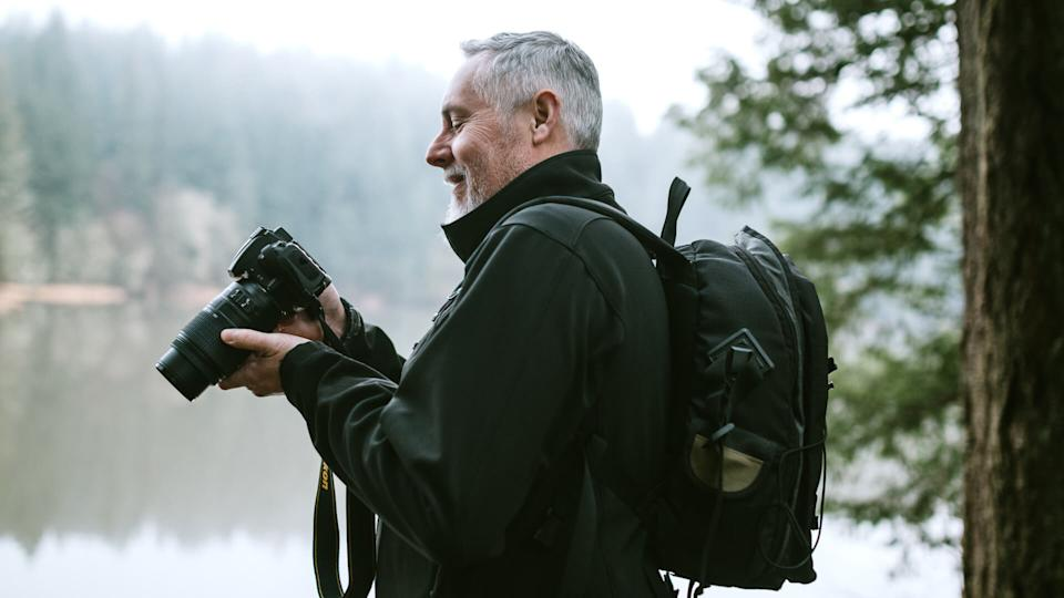 A man enjoys time outdoors in the Pacific Northwest, hiking beautiful forest trails and exploring rivers and waterfalls.