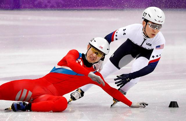 Short Track Speed Skating Events - Pyeongchang 2018 Winter Olympics - Men's 500 m Competition - Gangneung Ice Arena - Gangneung, South Korea - February 20, 2018. Thomas Insuk Hong of the U.S in action as Jong Kwang Bom of North Korea falls. REUTERS/John Sibley TPX IMAGES OF THE DAY