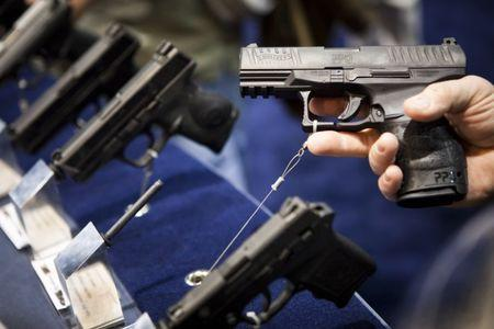 A Walther handgun is displayed at the Smith & Wesson booth at the Safari Club International Convention in Reno, Nevada, January 29, 2011.  REUTERS/Max Whittaker
