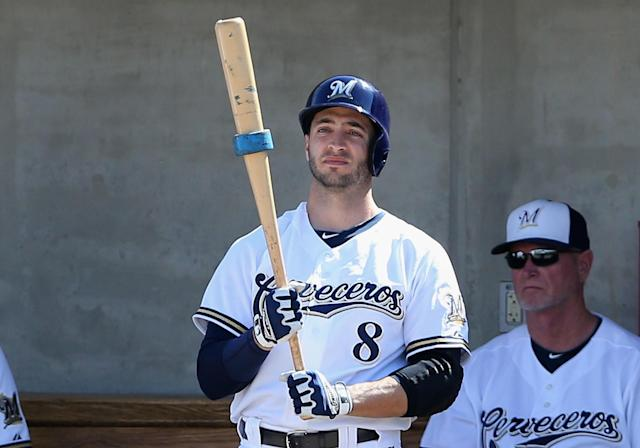 PHOENIX, AZ - MARCH 07: Ryan Braun #8 of the Milwaukee Brewers waits to bat in the dugout during the spring training game against the San Diego Padres at Maryvale Baseball Park on March 7, 2014 in Phoenix, Arizona. (Photo by Christian Petersen/Getty Images)