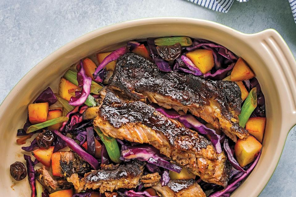 """Cook ribs over a mix of red cabbage and tart apples in this easy one-pot dinner. You'll need square pork ribs, Fuji apples, green onions, unsweetened cherries, red cabbage, Chinese five-spice powder, blackstrap molasses, Dijon mustard, apple cider vinegar, and ghee. <a href=""""https://www.epicurious.com/recipes/food/views/sticky-pork-spare-ribs-casserole?mbid=synd_yahoo_rss"""" rel=""""nofollow noopener"""" target=""""_blank"""" data-ylk=""""slk:See recipe."""" class=""""link rapid-noclick-resp"""">See recipe.</a>"""