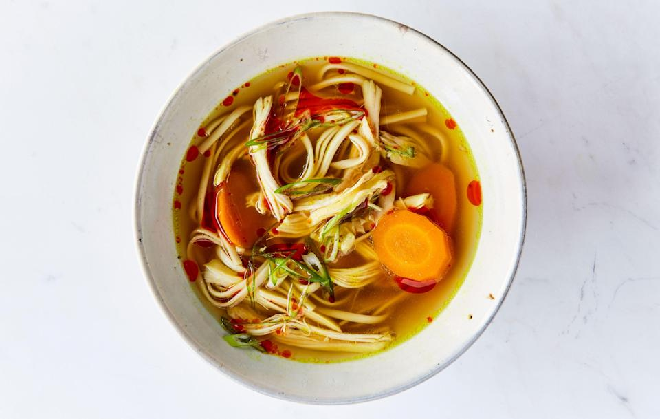 "Chicken noodle soup never gets old. If you don't have udon for this recipe, use rice noodles or regular old spaghetti. A small knob of fresh turmeric can replace the dried type. <a href=""https://www.bonappetit.com/recipe/turmeric-ginger-chicken-soup?mbid=synd_yahoo_rss"" rel=""nofollow noopener"" target=""_blank"" data-ylk=""slk:See recipe."" class=""link rapid-noclick-resp"">See recipe.</a>"