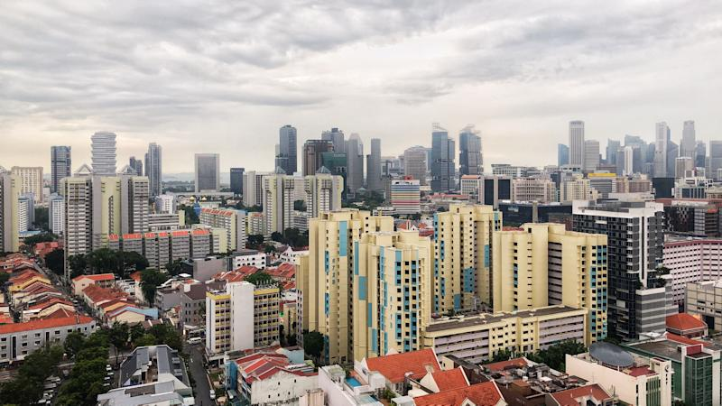 An afternoon aerial view of Singapore Central Little India region public housing estate. Foreground shows different blocks of public housing blocks and Singapore's city skyline formed by commercial towers and financial buildings within central downtown core district.