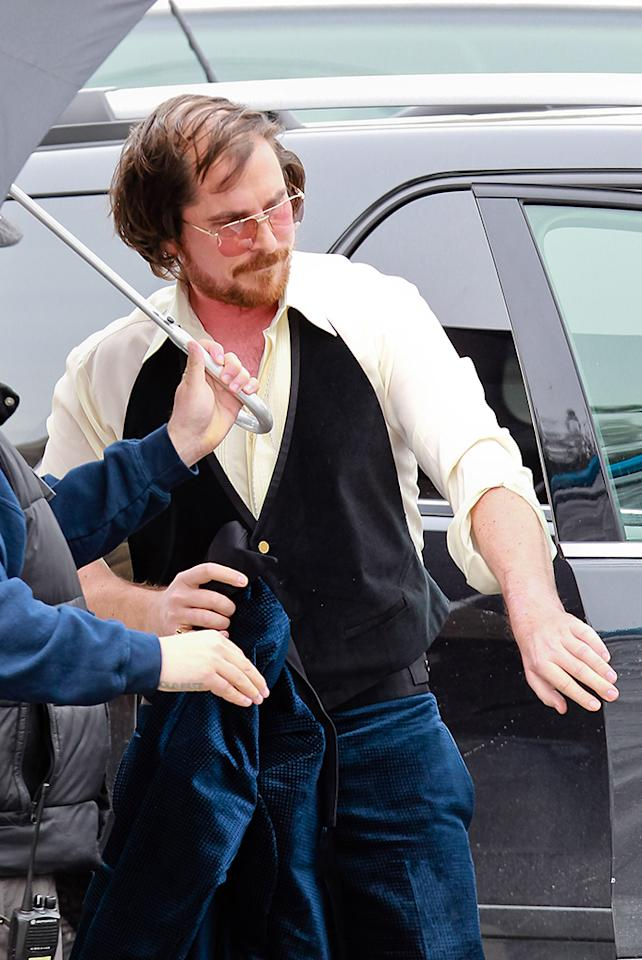 Christian Bale looks heavy and balding and wears 1970s attire on set of the untitled David O. Russell movie in Boston, Massachusetts. 