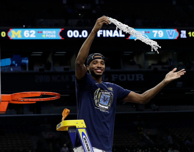 Villanova's Mikal Bridges cuts the net as he celebrates after the championship game of the Final Four NCAA college basketball tournament against Michigan, Monday, April 2, 2018, in San Antonio. Villanova won 79-62. (AP Photo/David J. Phillip)