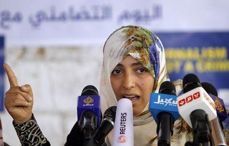 Nobel Peace Laureate Tawakul speaks to a group of journalists during a protest in Sanaa