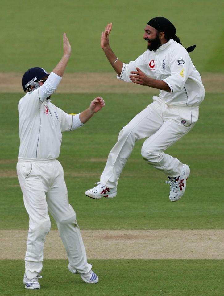 LONDON - MAY 20:  Monty Panesar of England celebrates the wicket of Corey Collymore of the West Indies with team-mate Ian Bell during the fourth day of the first npower test match between England and the West Indies at Lord's cricket ground on May 20, 2007 in London, England  (Photo by Mike Hewitt/Getty Images)