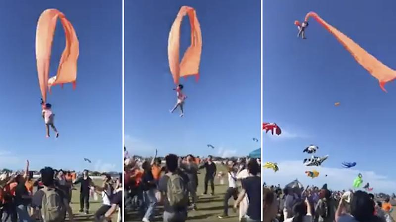 Little girl gets taken into the air by a kite