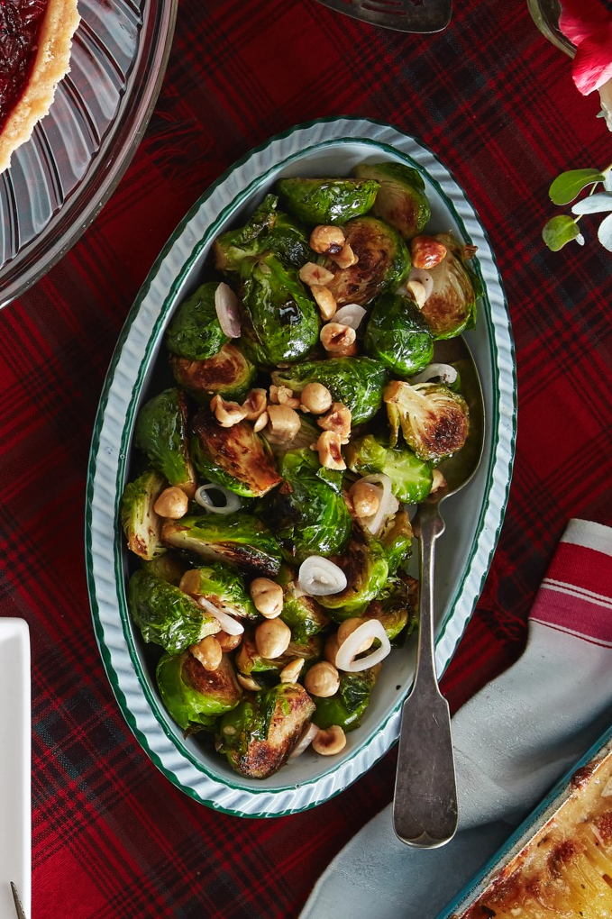 "<p>Liven up your Brussels sprouts so that everyone will want a serving. The pickled shallots and toasted hazelnuts add the perfect tang and crunch to this classic side dish.</p><p><strong><a href=""https://www.countryliving.com/food-drinks/a29626519/brussels-sprouts-with-pickled-shallots-and-hazelnuts-recipe/"" rel=""nofollow noopener"" target=""_blank"" data-ylk=""slk:Get the recipe"" class=""link rapid-noclick-resp"">Get the recipe</a>.</strong></p><p><a class=""link rapid-noclick-resp"" href=""https://www.amazon.com/Cuisinart-7117-16UR-Classic-Stainless-Rectangular/dp/B003YLJZ6M/ref=sr_1_4?tag=syn-yahoo-20&ascsubtag=%5Bartid%7C10050.g.635%5Bsrc%7Cyahoo-us"" rel=""nofollow noopener"" target=""_blank"" data-ylk=""slk:SHOP ROASTING PANS"">SHOP ROASTING PANS</a></p>"