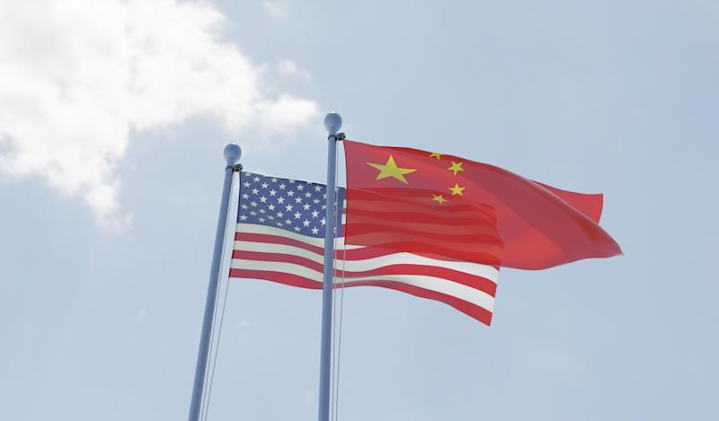 China and USA, two flags waving against blue sky. 3d image