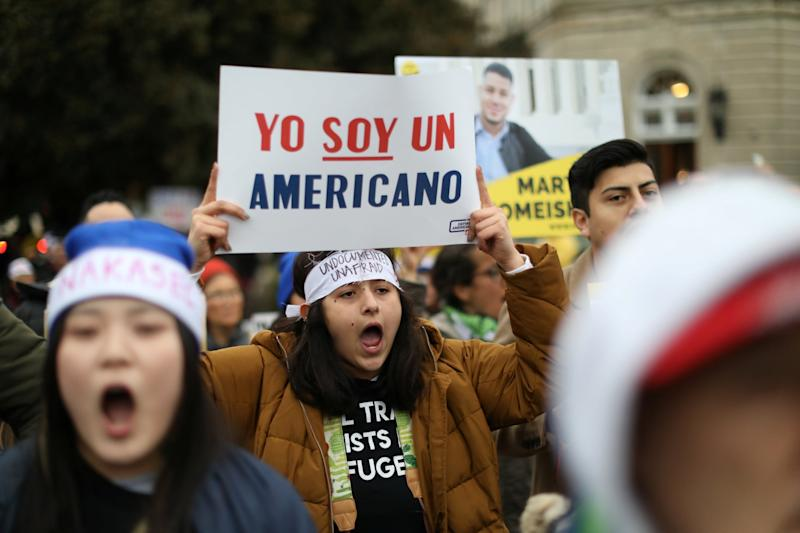 Protesters demonstrating in front of the Supreme Court as justices debate the Deferred Action for Childhood Arrivals programme: REUTERS