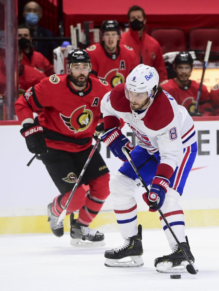 Montreal Canadiens defenseman Ben Chiarot (8) skates the puck up ice while taking on the Ottawa Senators during the first period of an NHL hockey game in Ottawa on Saturday, Feb. 6, 2021. (Sean Kilpatrick/The Canadian Press via AP)
