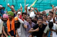 People shout slogans during a Maha Panchayat or grand village council meeting as part of a farmers' protest against farm laws in Muzaffarnagar