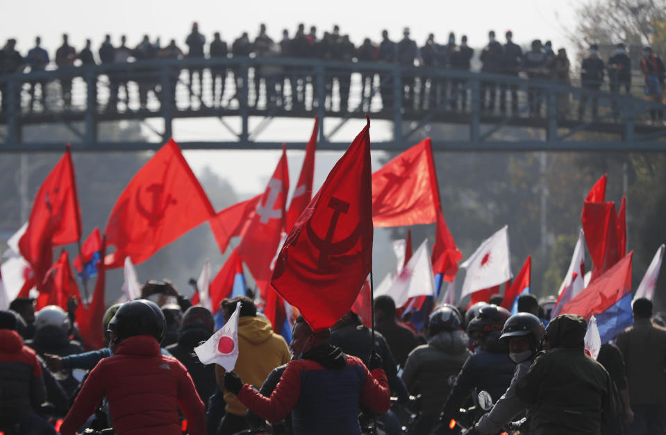 Nepalese supporters of the splinter group in the governing Nepal Communist Party participate in a protest in Kathmandu, Nepal, Tuesday, Dec. 29, 2020. Tens of thousands of supporters of the splinter group rallied in the capital on Tuesday demanding the ouster of the prime minister and the reinstatement of the Parliament he dissolved amid an escalating feud in the party. (AP Photo/Niranjan Shrestha)