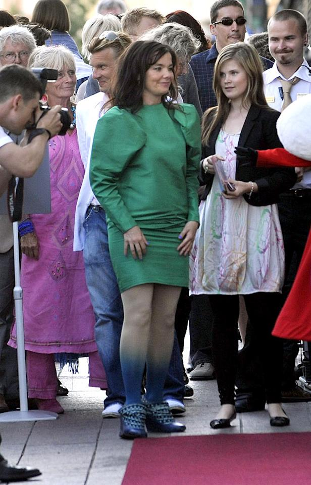 """At the Helsinki premiere of the Finnish animated film """"Moomins and the Comet Chase,"""" eccentric Icelandic chanteuse Bjork debuted an ill-fitting green dress with dip-dyed tights and blue booties. Worse looking than her iconic swan dress debacle from 2001? No doubt. <a href=""""http://www.infdaily.com"""" target=""""new"""">INFDaily.com</a> - August 2, 2010"""