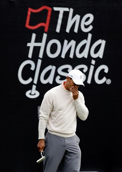 Tiger woods reacts to a shot on the 16th hole during the first round of the Honda Classic golf tournament, Thursday, Feb. 28, 2013, in Palm Beach Gardens, Fla. (AP Photo/Wilfredo Lee)