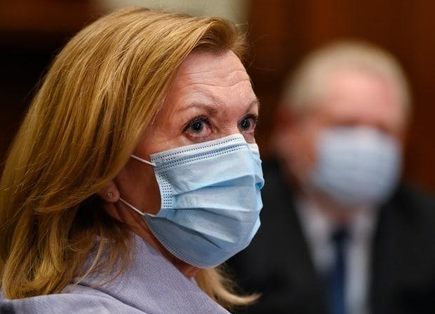 Ontario Health Minister Christine Elliott listens as Ontario Premier Doug Ford gives an update regarding the Ontario COVID-19 vaccine during the COVID-19 pandemic in Toronto on Tuesday, January 5, 2021. (Nathan Denette/The Canadian Press - image credit)