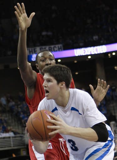 Creighton's Doug McDermott (3) drives for a basket past Illinois State's John Wilkins, in the second half of an NCAA college basketball game in Omaha, Neb., Wednesday, Feb. 1, 2012. Creighton won 102-74. (AP Photo/Nati Harnik)