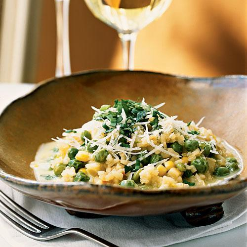 """<p>All over the country, summer markets are full of fresh, locally grown corn. It's put to delicious use in this dish. We loved the Corn Broth and thought it would make a tasty summer soup all by itself.</p> <p> <a rel=""""nofollow noopener"""" href=""""http://www.myrecipes.com/recipe/sweet-pea-risotto-with-corn-broth"""" target=""""_blank"""" data-ylk=""""slk:View Recipe: Sweet Pea Risotto with Corn Broth"""" class=""""link rapid-noclick-resp"""">View Recipe: Sweet Pea Risotto with Corn Broth</a></p>"""