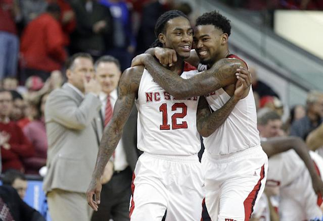 North Carolina State's Anthony Barber (12) and Trevor Lacey celebrate near the end of an NCAA college basketball game against Duke in Raleigh, N.C., Sunday, Jan. 11, 2015. North Carolina State won 87-75. (AP Photo/Gerry Broome)