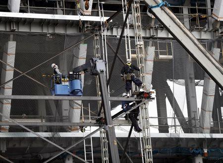 Workers are seen at the construction site of the Tokyo Aquatics Centre for Tokyo 2020 Olympic and Paralympic games in Tokyo, Japan February 12, 2019. REUTERS/Issei Kato