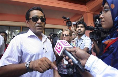 Progressive Party of Maldives (PPM) presidential candidate Abdulla Yameen speaks to the media after casting his vote at a polling station during the presidential elections in Male