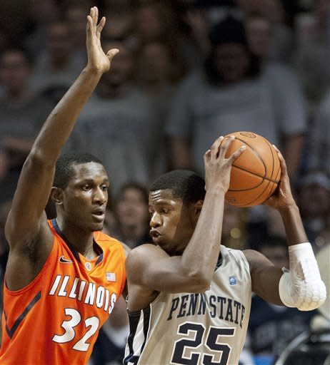 Illinois' Nnanna Egwu (32) defends Penn State's Jon Graham (25) during the first half of an NCAA college basketball game in State College, Pa., Thursday, Jan. 19, 2012. (AP Photo/Andy Colwell)