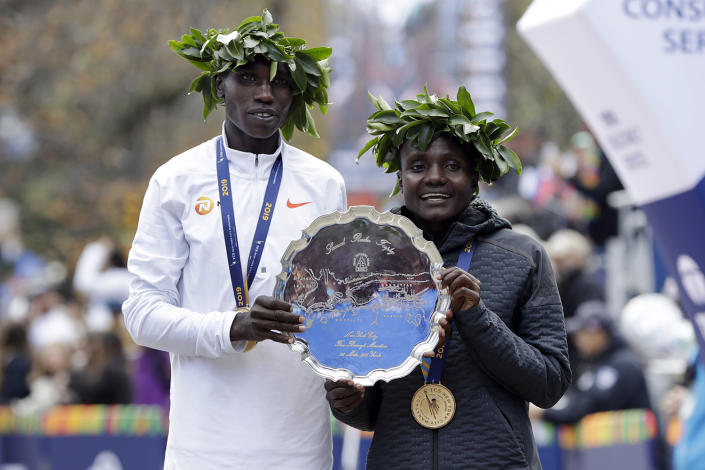 Geoffrey Kamworor, left, and Joyciline Jepkosgei, both of Kenya, pose for photos as the men's and women's winners of the New York City Marathon, in New York's Central Park,Nov. 3, 2019. (Photo: Richard Drew/AP)