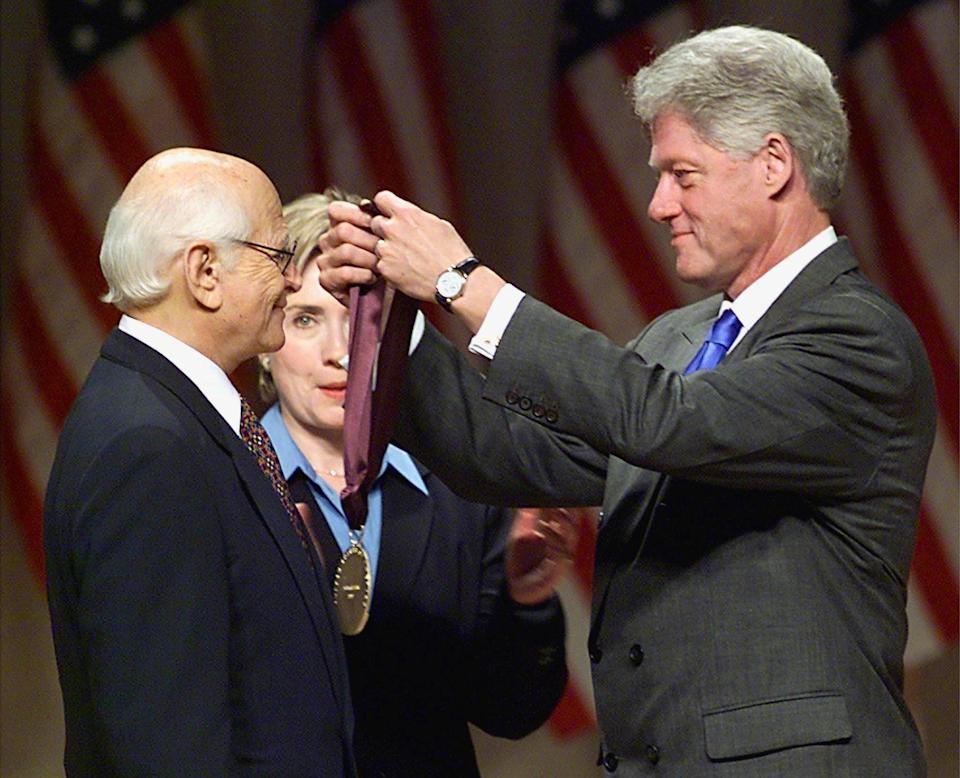 """<p>In 1999, President Bill Clinton (with First Lady Hillary Clinton) presented Lear with the National Medal of Arts, the highest honor given to artists by the government. </p> <p>""""Norman Lear has held up a mirror to American society and changed the way we look at it,"""" the president said in his remarks.</p>"""