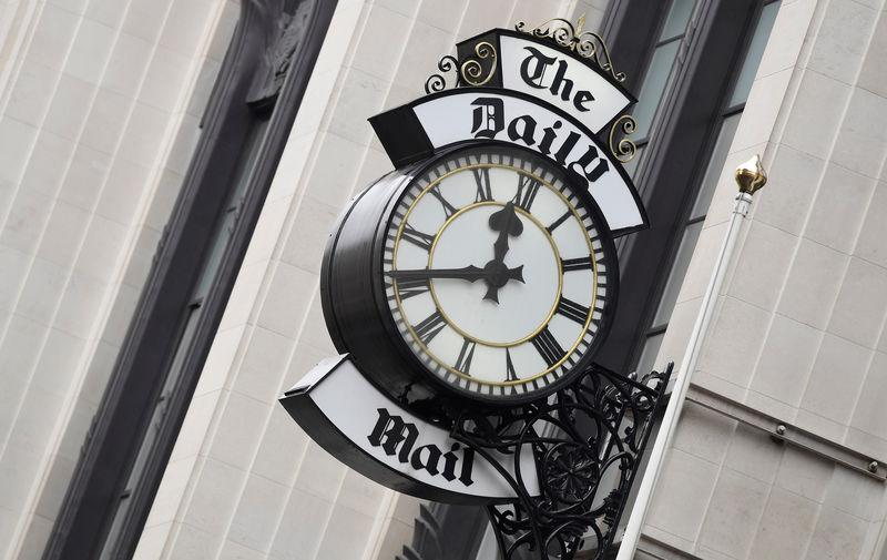 A clock face is seen outside of the London offices of the Daily Mail newspaper in London, Britain