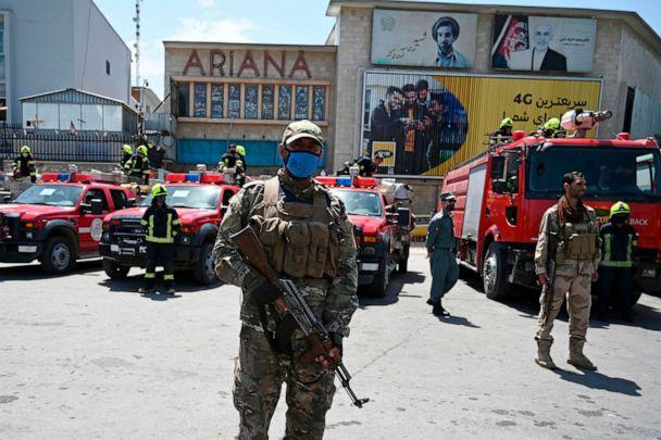 PHOTO: Afghan policemen stand guard as they wait for the firefighters from the government emergency committee to arrive for spraying disinfectant on a street as a preventive measure against the spread of COVID-19, in Kabul, June 18, 2020. (Wakil Kohsar/AFP via Getty Images)