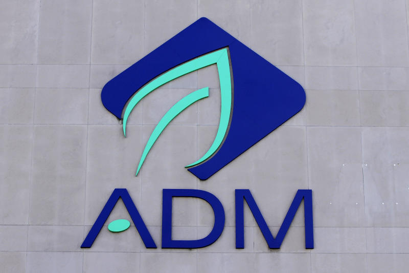 CORRECTS DATE OF NEWS RELEASE TO SEPT. 23, 2013 NOT 2012 AS SENT - FILE - In this Sept. 12, 2012 file photo, the Archer Daniels Midland Company logo is seen on the headquarter office in Decatur, Ill. In a news release Monday, Sept. 23, 2013, the agribusiness giant said that after 44 years in Decatur, it is looking for a new location for its headquarters. CEO Patricia Woertz said ADM needs what she called a global center with better access to customers and other employees around the world. (AP Photo/Seth Perlman, File)