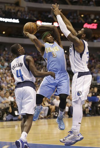 Denver Nuggets point guard Ty Lawson (3) looks to pass against Dallas Mavericks guards Darren Collison (4) and guard O.J. Mayo (32) during the first half of an NBA basketball game on Friday, April 12, 2013, in Dallas. (AP Photo/LM Otero)