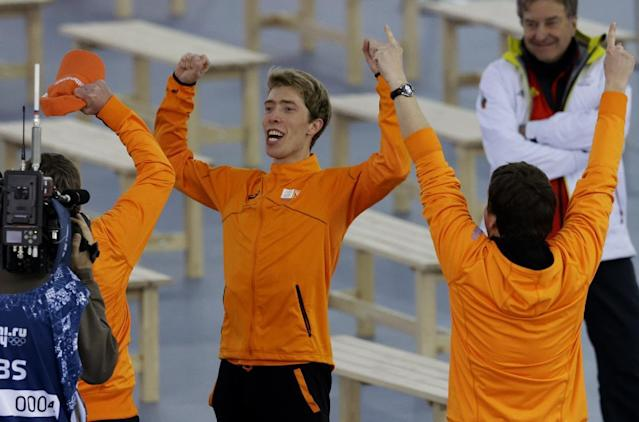 Gold medallist Jorrit Bergsma of the Netherlands celebrates after the final race in the men's 10,000-meter speedskating race at the Adler Arena Skating Center during the 2014 Winter Olympics in Sochi, Russia, Tuesday, Feb. 18, 2014. (AP Photo/Patrick Semansky)