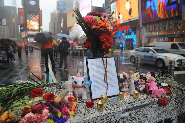 <p>A letter written by Thomas Elsman's 18-year-old daughter, Alyssa, who was killed Thursday, May 18, sits on top of a temporary memorial near the site where a speeding car plowed into crowds of people in Times Square, New York City, on May 22, 2017. (Photo: Gordon Donovan/Yahoo News) </p>