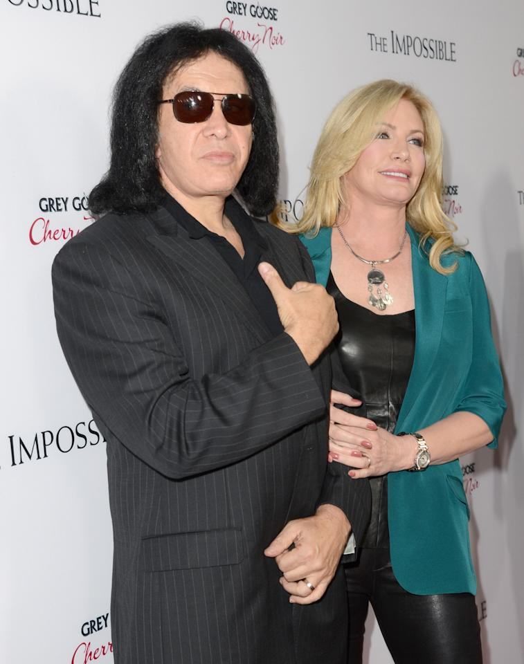 """HOLLYWOOD, CA - DECEMBER 10:  Musician Gene Simmons (L) and Shannon Tweed attend the Los Angeles premiere of Summit Entertainment's """"The Impossible"""" at ArcLight Cinemas Cinerama Dome on December 10, 2012 in Hollywood, California.  (Photo by Jason Merritt/Getty Images)"""