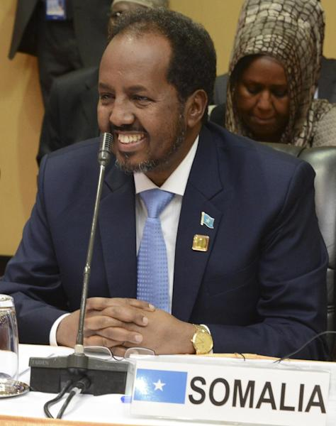 Somali President Hassan Sheikh Mohamud attends the closing meeting for the African Union Mission in Somalia AMISOM at Speke Resort Munyonyo in Uganda capital Kampala Sunday Aug. 4, 2013. Regional leaders say they want Somalia's central government to take control of Kismayo, a disputed port city that has been the scene of fighting between rival militias. (AP Photo/Stephen Wandera)