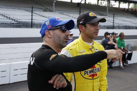May 19, 2018; Speedway, IN, USA; Verizon IndyCar Series driver Tony Kanaan (left) talks with Helio Castroneves during qualifications for the 102nd Running of the Indianapolis 500 at Indianapolis Motor Speedway. Mandatory Credit: Brian Spurlock-USA TODAY Sports