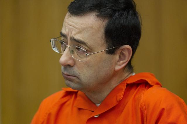 Larry Nassar allegedly drugged and raped a Michigan State student athlete in 1992, but the athletic director intervened to cover it up. (Cory Morse /The Grand Rapids Press via AP, File)