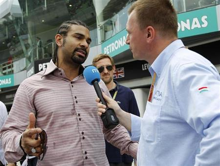 Former proffesional boxer David Haye talks to the media in the pit lane of the Sepang International Circuit outside Kuala Lumpur ahead of the Malaysian F1 Grand Prix