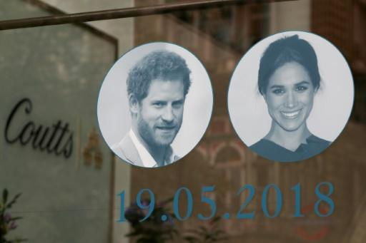 Pictures of Britain's Prince Harry and his fiancee, US actress Meghan Markle are displayed in a shop window in central London
