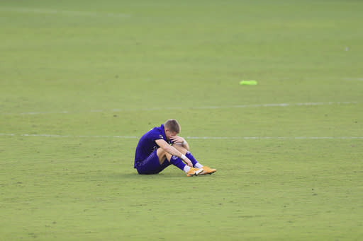 Orlando City forward Chris Mueller (9) sits on the pitch after an MLS playoff soccer match against the New England Revolution, Sunday, Nov. 29, 2020, in Orlando, Fla. (AP Photo/Matt Stamey)