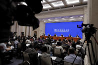 Journalists attend a press conference for the white paper on China's fighting of the Covid-19 coronavirus chaired by Xu Lin, vice head of the publicity department of the communist party, at the State Council Information Office in Beijing, Sunday, June 7, 2020. Senior Chinese health officials defended their country's response to the new coronavirus pandemic, saying they provided information in a timely and transparent manner. (AP Photo/Andy Wong)